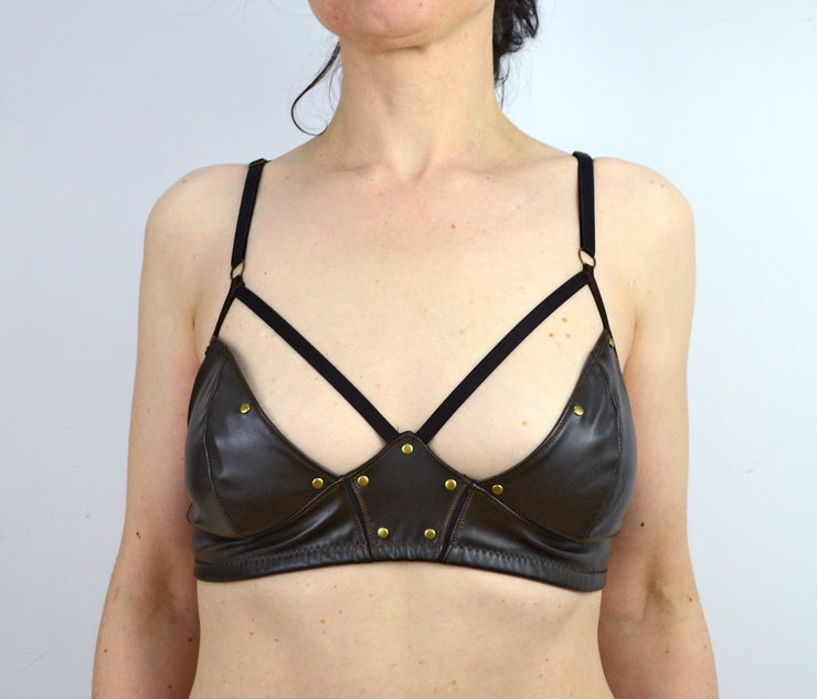 woman wearing strappy faux leather thor bra lingerie by knickerocker