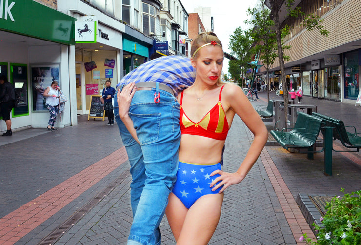 girl carrying boy wearing wonder woman lingerie set