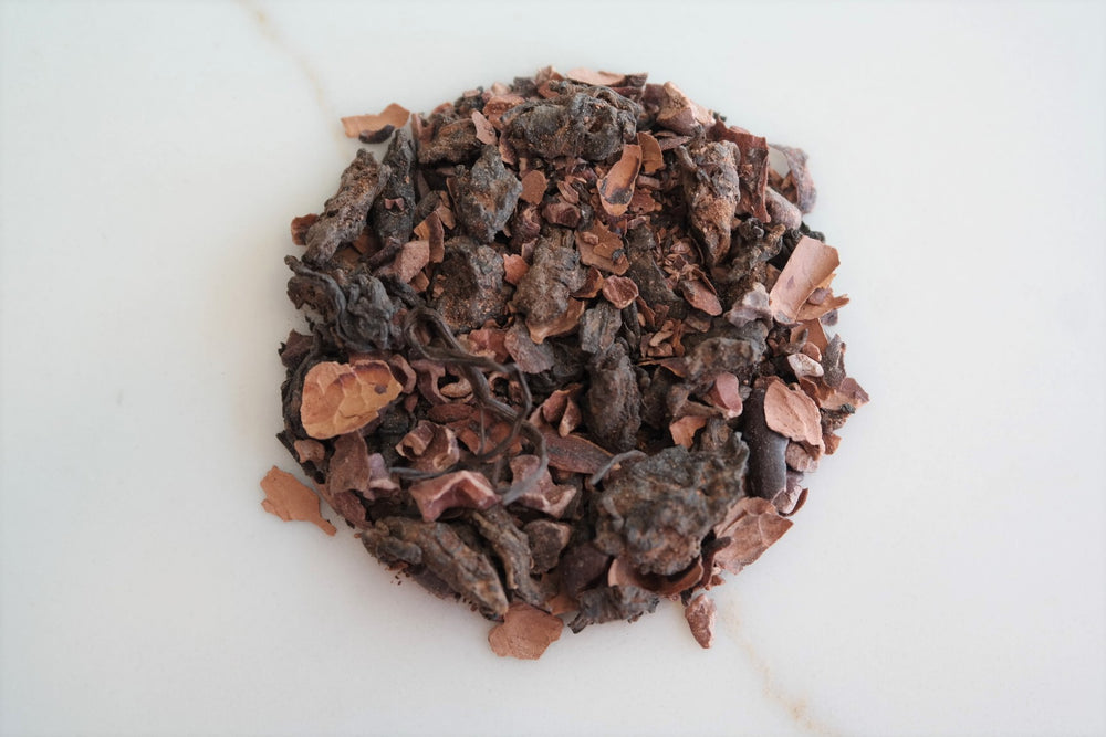 This Casablanca Teas house-blend is made with loose leaf puer from Yunnan and Hawaiian grown cacao.  Chocolate Puer yields a pink, amber brew with an earthy flavor and dark chocolate finish