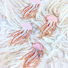 Load image into Gallery viewer, Four rose gold pastel jellyfish pins on a white textured pillow