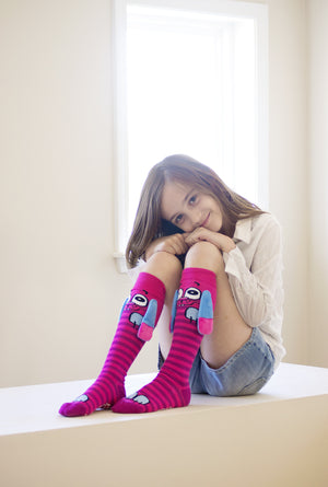 little girl wearing pink cute socks