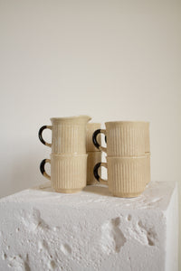 Vintage tan and brown stoneware mugs and creamer set (D234)