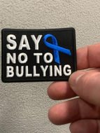 Say no to bulling with blue ribbon patch