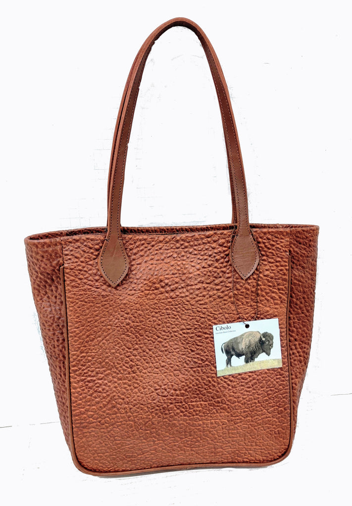 "#3500 Cinnamon  Tote in American Bison Features Gussets and American Bridle Leather Piping. Dimensions: 12.5 "" H x 15"" L x 4"" D"