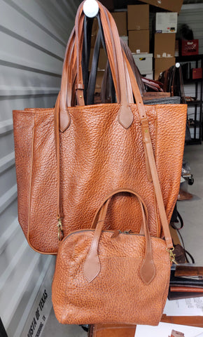 "3514 Large Tote in American Bison - side Gussets & Piping. Color: Cinnamon Cobblestone. Snap closure. Dimensions: 14"" H x 17"" L x 5"" D"