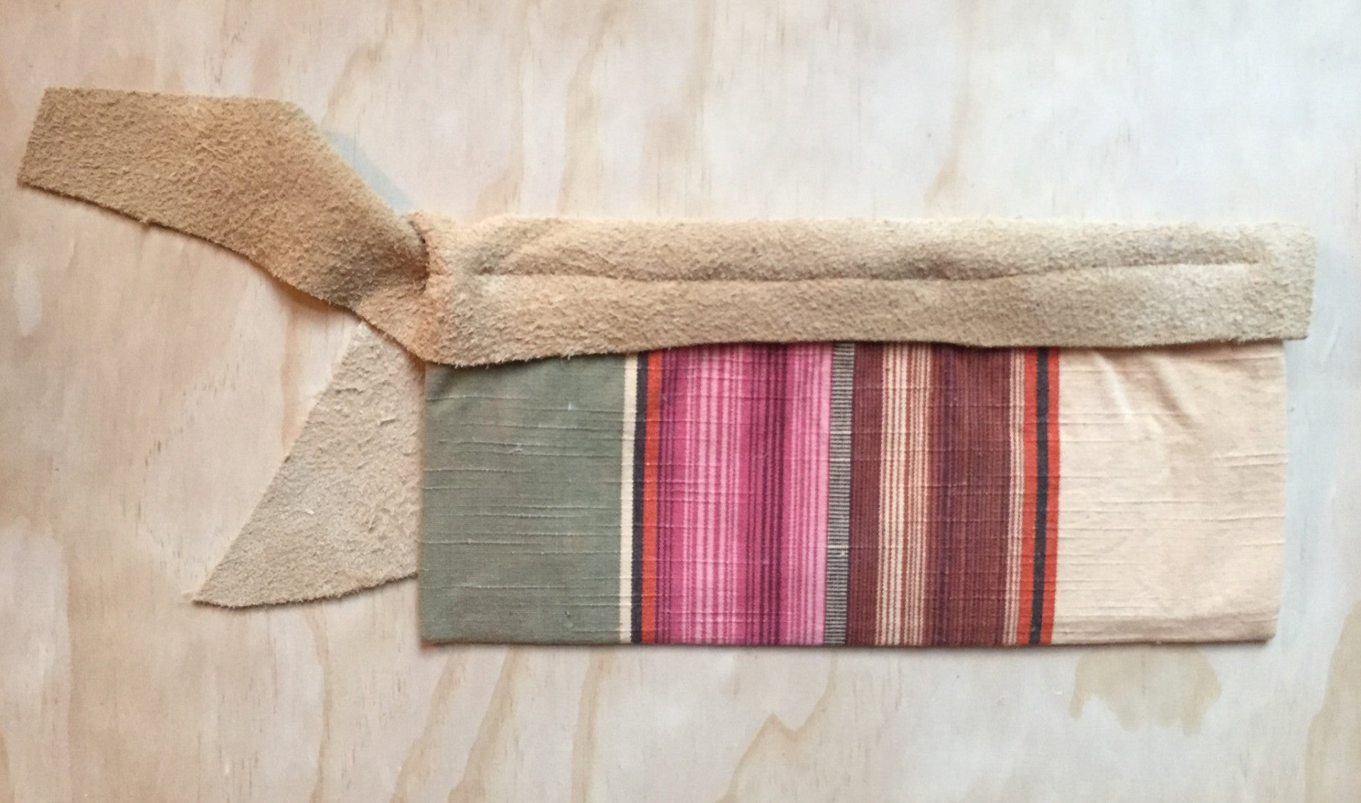 tan earth stripe clutch