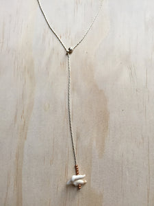 coyote tooth and copper necklace