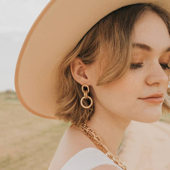 cora gold statement earrings