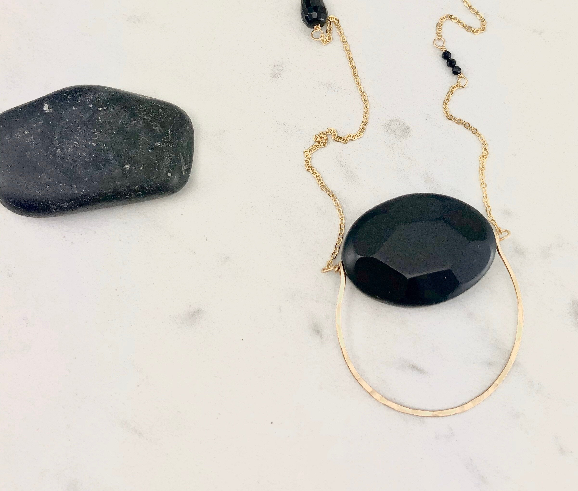 Handmade Gold and Onyx Swing Pendant