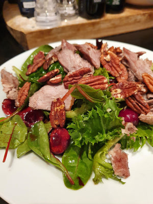 Cherry and duck salad with extra virgin olive oil Opus olea
