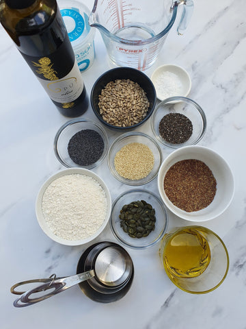 Ingredients for seeded crackers with olive oil