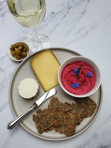Seed crackers with cheese and dip