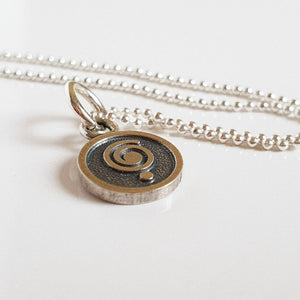 "Medallion ""The Spiral Can Take You Anywhere"""