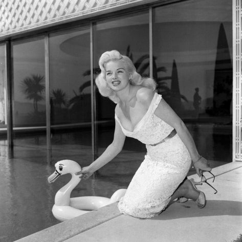 actress-diana-dors-with-an-inflatable-swan-as-she-poses-by-a-swimming-pool-at-cannes-film-festival_i-G-30-3011-WJ8BF00Z