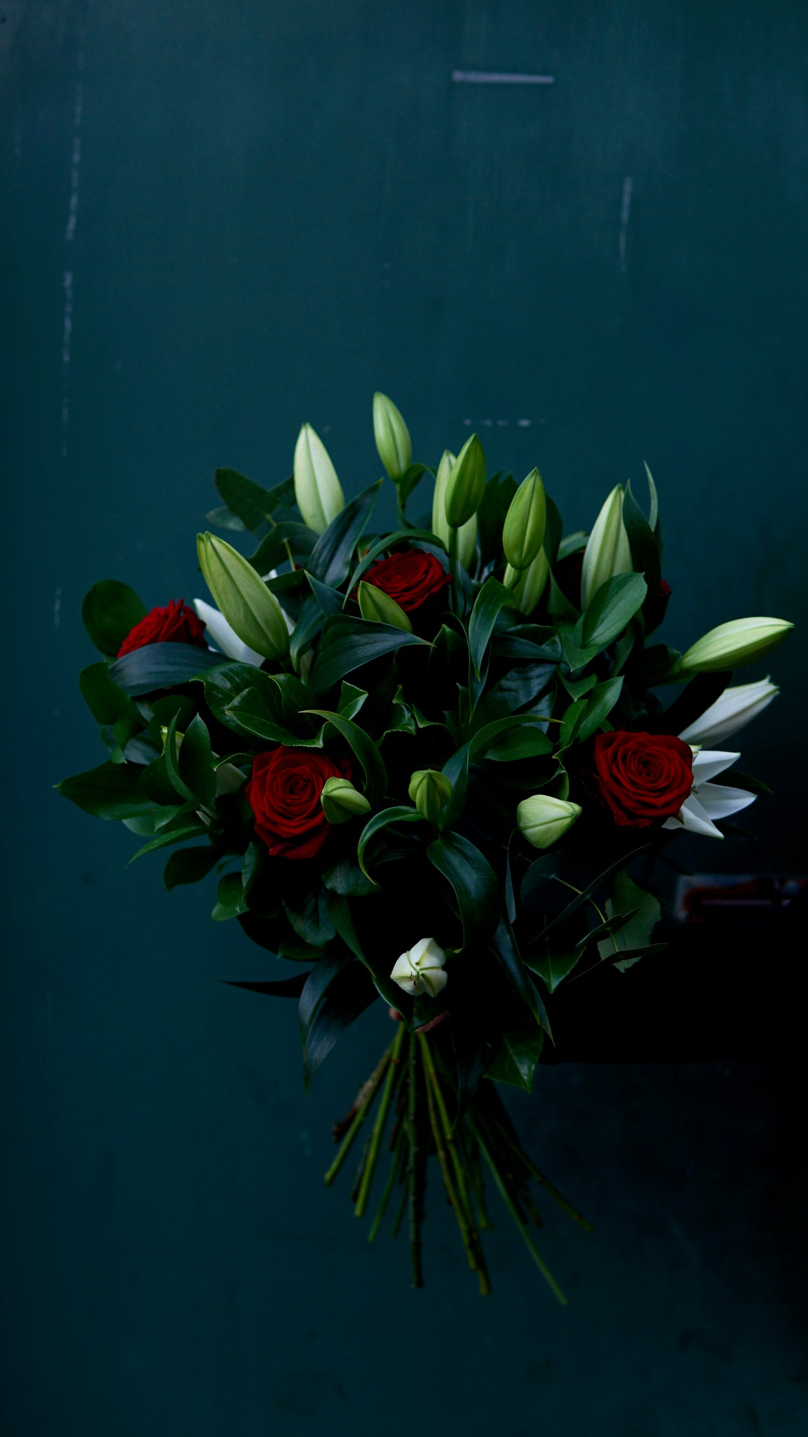 White Lily's and 6 red roses bouquet