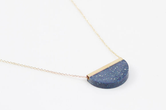 blue corian half circle pendant with brass top chain through top