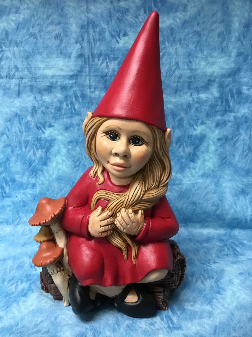 Friendly Girl Gnome Sitting with Mushrooms
