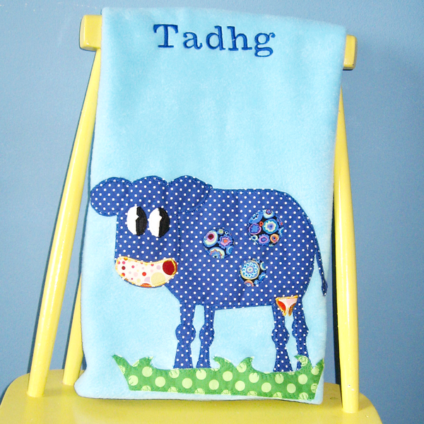 Personalized Fleece aqua baby blanket with applique cow design.