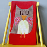 Handmade personalised baby blanket in red with spotty appliqué owl design. Made in Ireland by Pippablue.
