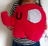 Pink Elephant shaped cushion in fleece with floppy cotton ears and cotton tail.