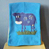 Personalised Fleece blue baby blanket with applique cow design.