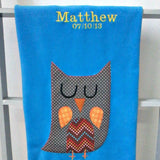 Handmade personalised baby blanket in turquoise blue with spotty appliqué owl design. Made in Ireland by Pippablue.