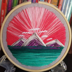Landscape embroidery with mountains
