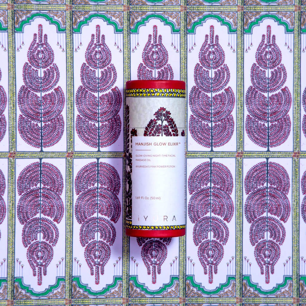 Manjish Glow Elixir and other iYURA products showing off their beautiful packaging with Madhubani painting