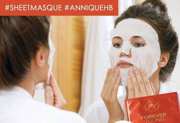 Woman with an Annique sheet masque on her face