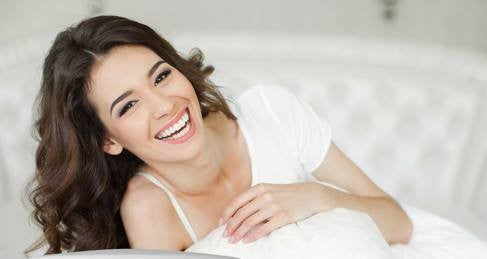 Woman smiling with happy skin