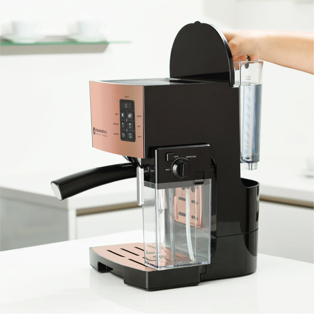 Easily remove, refill, and clean the water tank of the 10-Piece Rose Gold Espresso & Cappuccino Maker Set