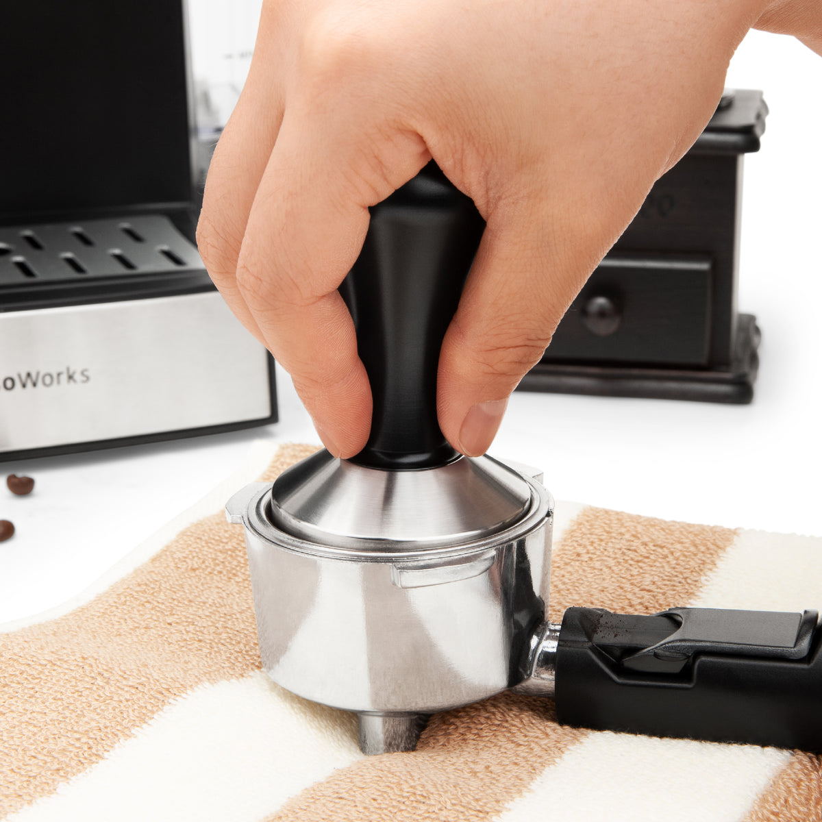 EspressoWorks Espresso Tamper Black expertly tamps in coffee grinds to make a puck for a balanced brew