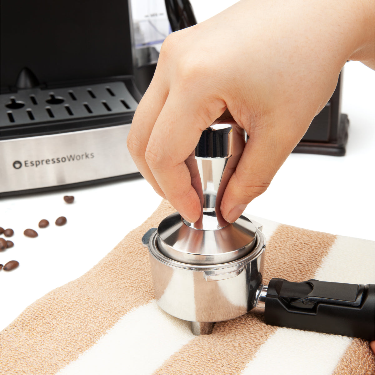 EspressoWorks Espresso Tamper Stainless Steel expertly tamps in coffee grinds to make a puck for a balanced brew