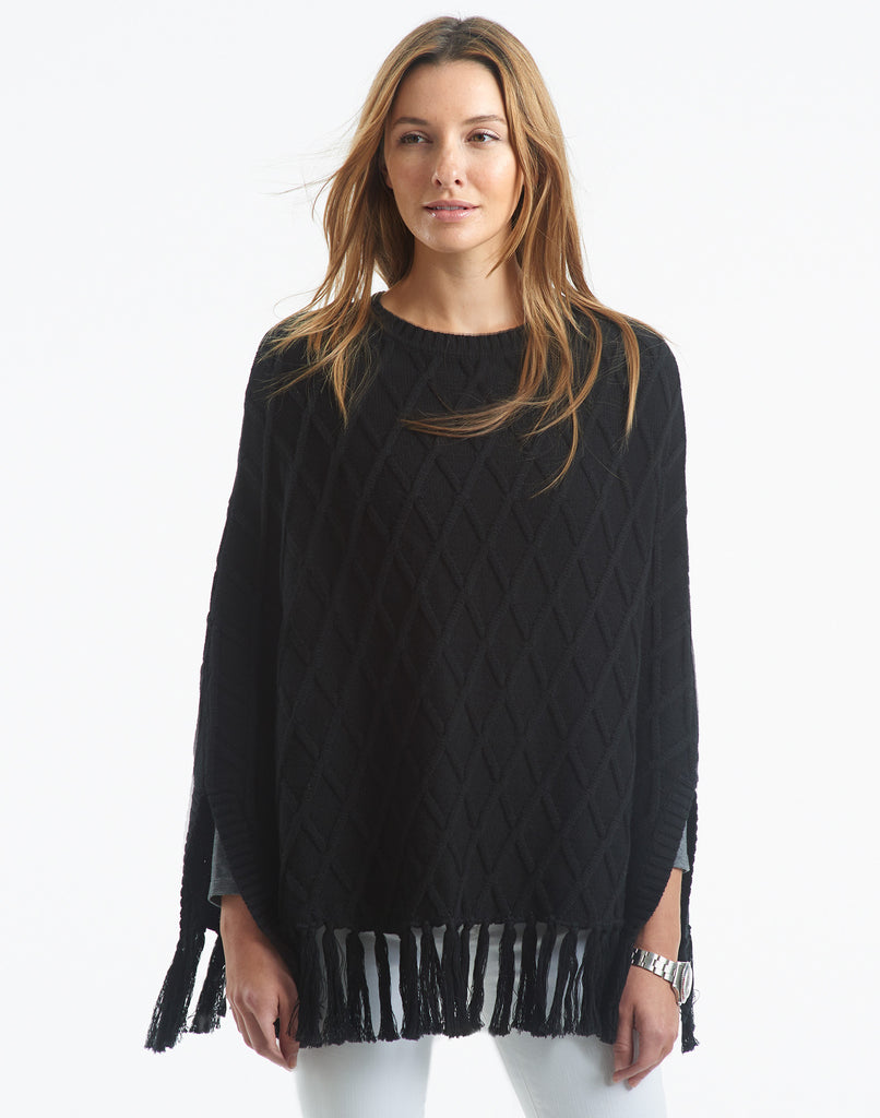 Black and Grey Peruvian Knit Bohemian Drape Poncho Peruvian artisan Alfredo Falcon captures the perfect elegance of black and pale grey in this knit poncho. A long drape and V-neck make this poncho a modern piece perfect for cool days and nights.