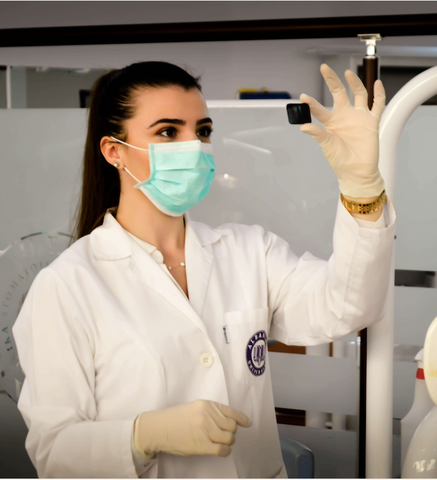 Woman with face mask in laboratory