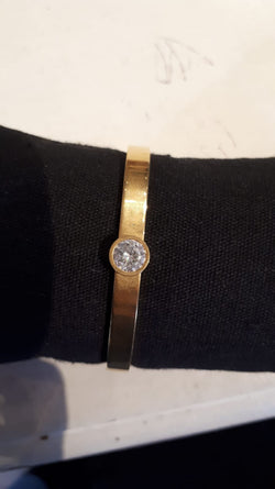 Armband staal, goud met strass steentje