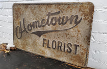 "Load image into Gallery viewer, Embossed Metal ""Hometown Florist"" Sign"