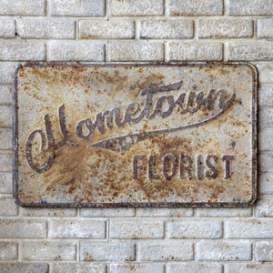 "Embossed Metal ""Hometown Florist"" Sign"