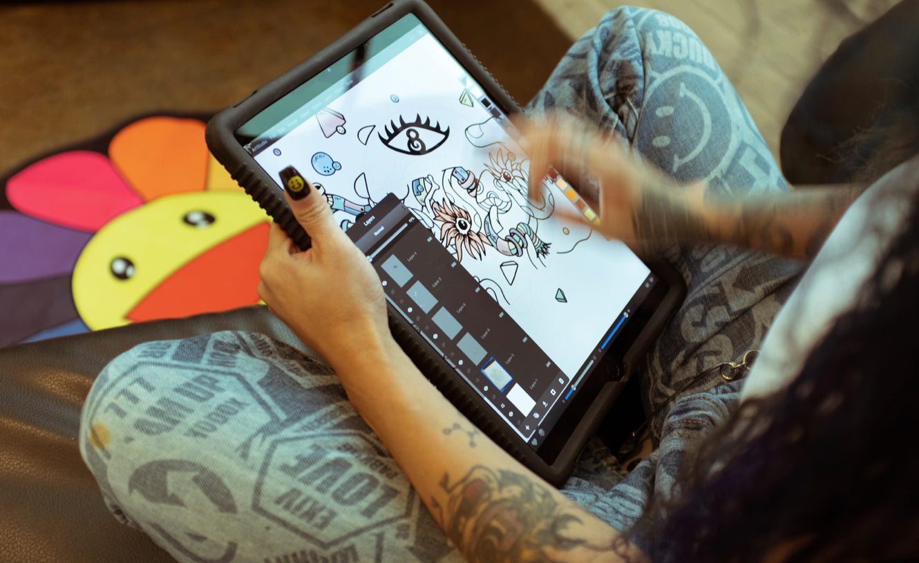 Distortedd's hand is blurred as she sketches the Magic 8 Ball on her iPadPaint