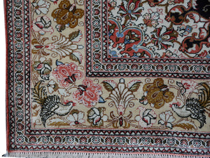 Qum pure silk rug - collectors item Classic vintage silk rugs Origin: Qum Design: Floral with medaillon Colors: indigo blue, gold, red, green Pile hand-knotted 100% pure natural mulberry silk Size: small rugs - also for wall decoration Age: Approx. 1970/80 Condition: Very good, side edges and fringes rstored, freshly washed  Knot density: 600 kpsi