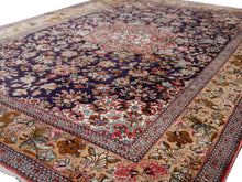 Load image into Gallery viewer, Qum pure silk rug - collectors item Classic vintage silk rugs Origin: Qum Design: Floral with medaillon Colors: indigo blue, gold, red, green Pile hand-knotted 100% pure natural mulberry silk Size: small rugs - also for wall decoration Age: Approx. 1970/80 Condition: Very good, side edges and fringes rstored, freshly washed  Knot density: 600 kpsi