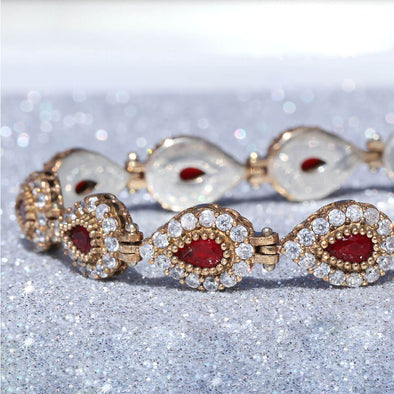 go-ahead-ruby-red-pear-shaped-silver-bracelet