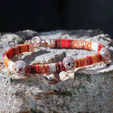 skulls-on-orange-cotton-silver-wave-bracelet