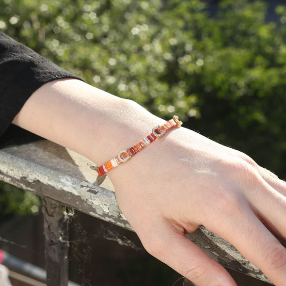 superstitiously-lucky-horseshoe-orange-cotton-silver-wave-bracelet-1