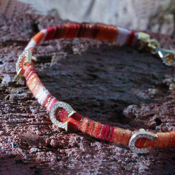 superstitiously-lucky-horseshoe-orange-cotton-silver-wave-bracelet