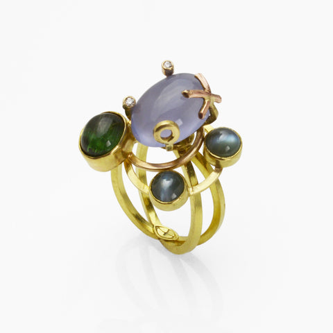 Lysithea Orbit Ring in 18k gold with rare gems in vivid ocean hues