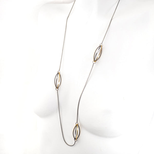 Lattis Long Necklace with Three Streamline Shapes in Sterling Silver, 22k gold and Blackened Patina