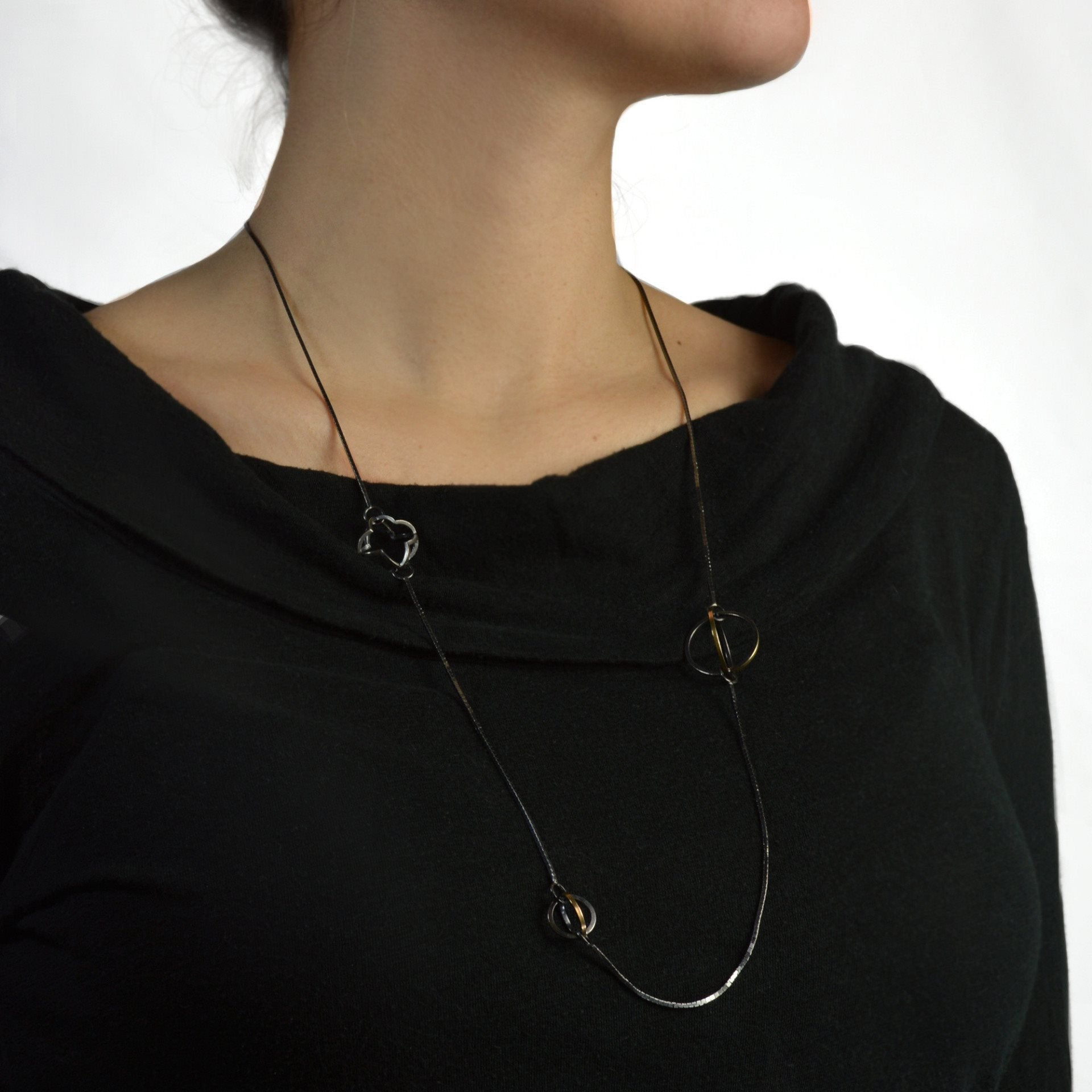 Black Patina on Sterling Silver with 22k Gold Highlight the Geometric Shapes on This Long Necklace