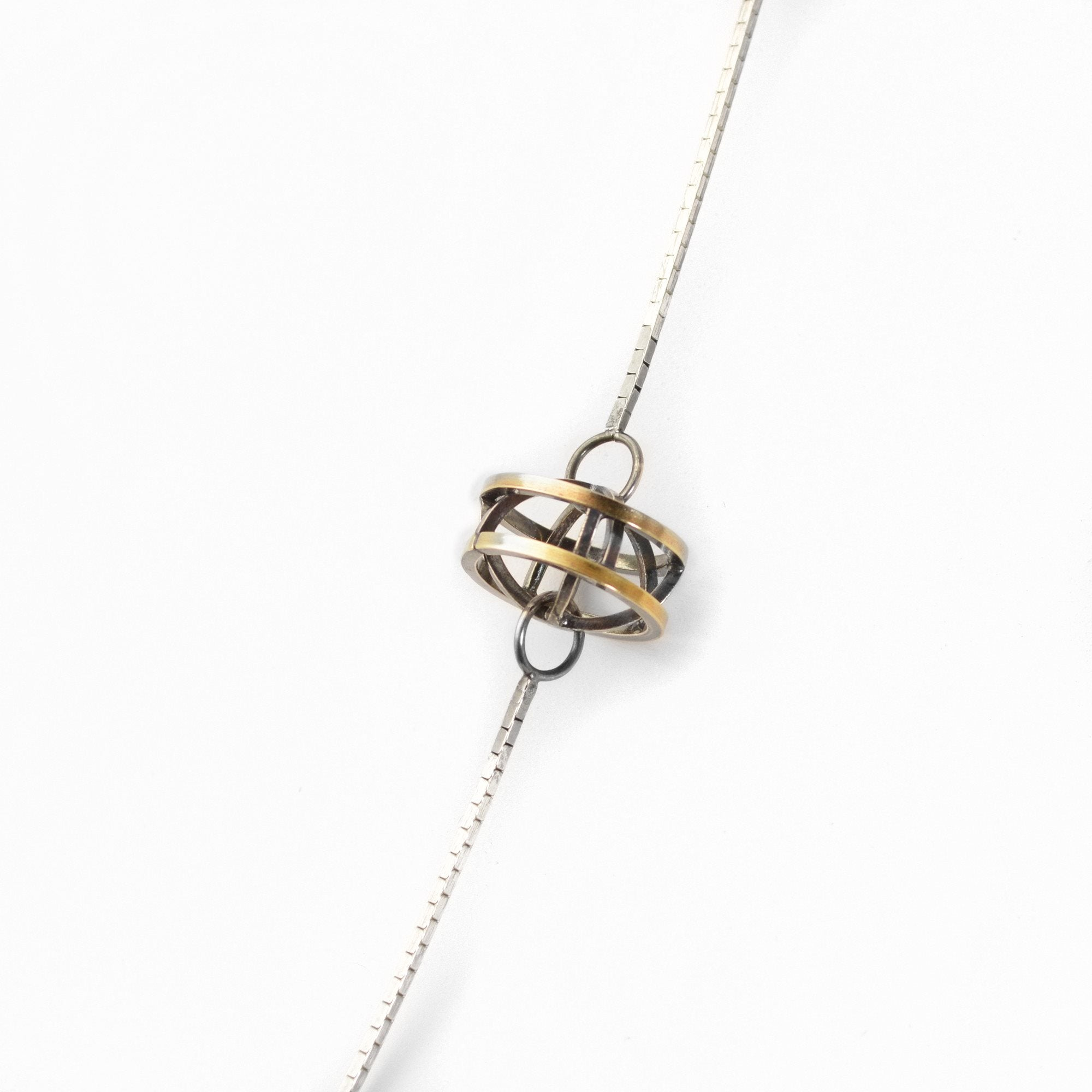 Lattis Long Necklace in Black and Gold with three Geometric Stations