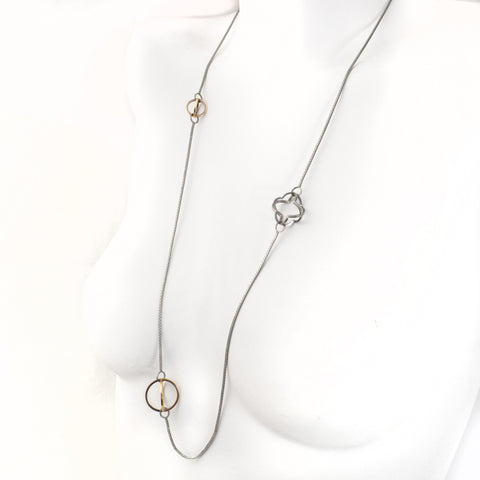 Three Dimensional Quatrefoil and Spheres are lit with 22k gold and contrasting Blackened Sterling Silver Long Necklace
